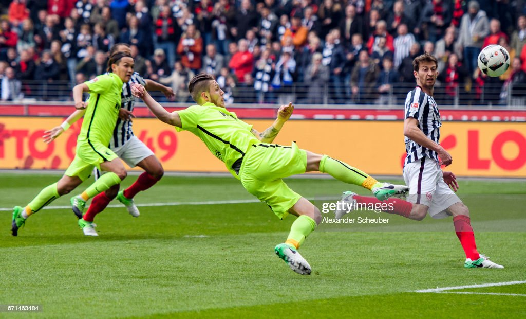 Jeffrey Gouweleeuw of Augsburg scores the first goal for his team during the Bundesliga match between Eintracht Frankfurt and FC Augsburg at Commerzbank-Arena on April 22, 2017 in Frankfurt am Main, Germany.