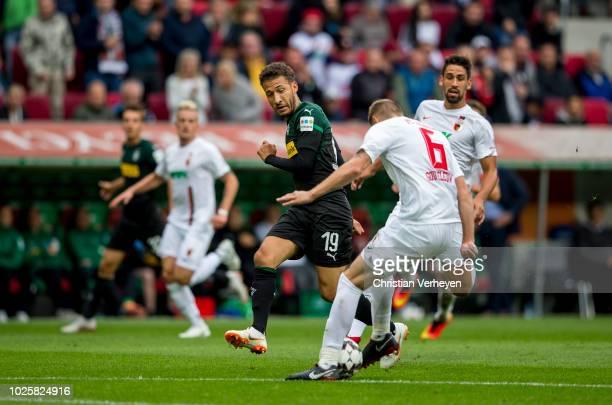 Jeffrey Gouweleeuw of FC Augsburg and Fabian Johnson of Borussia Moenchengladbach in action during the Bundesliga match between FC Augsburg and...