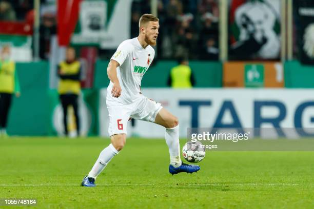Jeffrey Gouweleeuw of FC Augsburg controls the ball during the DFB Cup match between FC Augsburg and 1 FSV Mainz 05 at WWKArena on October 30 2018 in...