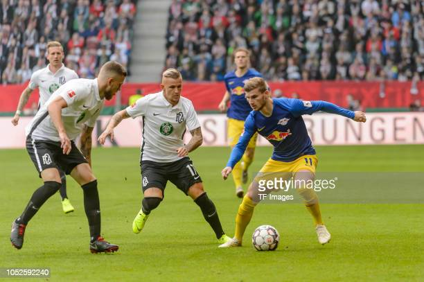 Jeffrey Gouweleeuw of FC Augsburg Jonathan Schmid of FC Augsburg and Timo Werner of RB Leipzig battle for the ball during the Bundesliga match...