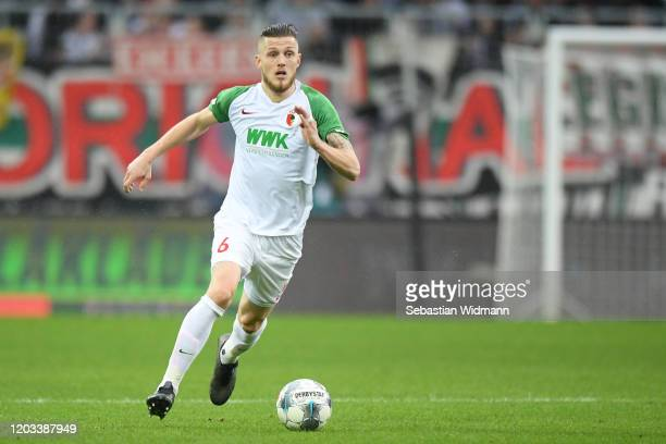 Jeffrey Gouweleeuw of FC Augsburg plays the ball during the Bundesliga match between FC Augsburg and SV Werder Bremen at WWK-Arena on February 01,...