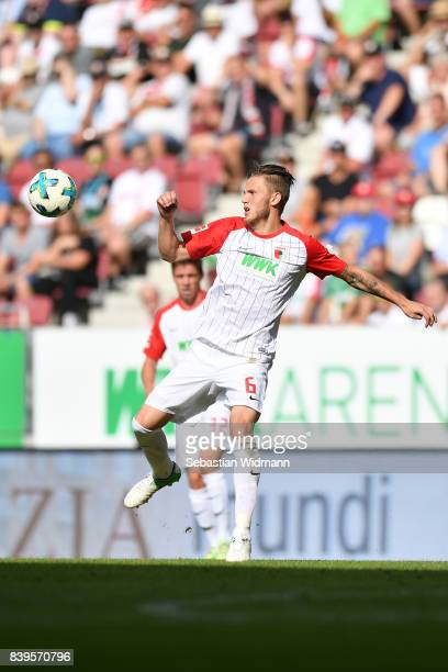Jeffrey Gouweleeuw of FC Augsburg plays the ball during the Bundesliga match between FC Augsburg and Borussia Moenchengladbach at WWKArena on August...