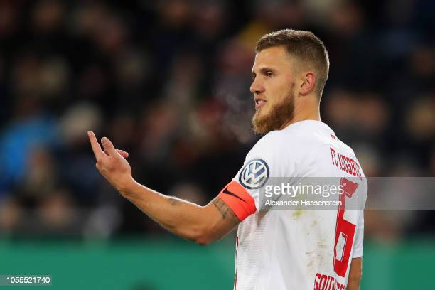 Jeffrey Gouweleeuw of FC Augsburg reacts during the DFB Cup match between FC Augsburg and 1. FSV Mainz 05 at WWK-Arena on October 30, 2018 in...