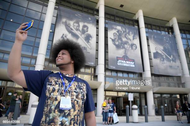 Jeffrey Grant, of Athen, Ga., makes a selfie photograph of himself outside the Orange County Convention Center during the Star Wars Celebration event...