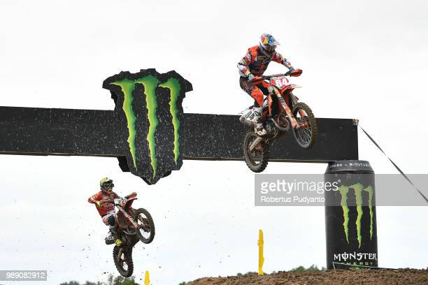 PANGKALPINANG BANGKA INDONESIA JULY 01 Jeffrey Herlings of Red Bull KTM Factory Racing Team leads to Antonio Cairoli of Red Bull KTM Factory Racing...