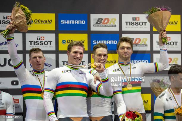 Jeffrey Hoogland, Harrie Lavreysen, Roy van den Berg and Matthijs Buchli of The Netherlands celebrate during medal ceremony after winning Men's Team...