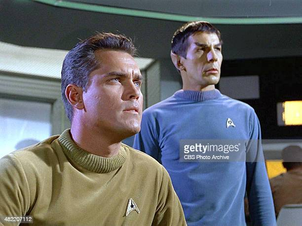 Jeffrey Hunter as Captain Christopher Pike and Leonard Nimoy as Commander Spock on the bridge of the USS Enterprise in the STAR TREK The Original...
