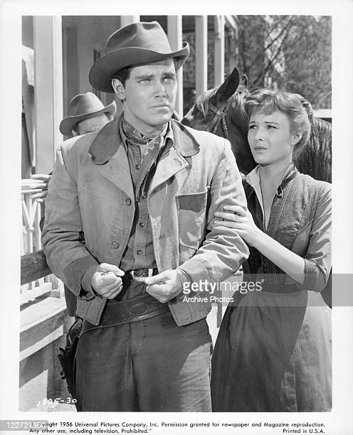 Jeffrey Hunter walks wiith Janice Rule who's holding his arm in a scene from the film 'Gun For A Coward' 1957