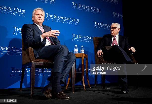 Jeffrey Immelt chief executive officer of General Electric Co left speaks with David Rubenstein cofounder and joint managing director of the Carlyle...