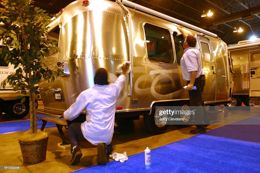 Jeffrey James, left, and Jef [cq] Fleming of Windish RV Centers, Inc. of Lakewood polish the exterior of a 22-foot Airstream CCD travel trailer in preparation for the 13th Annual Colorado RV Adventure Travel Show. The show, which runs Thursday through Sun : News Photo