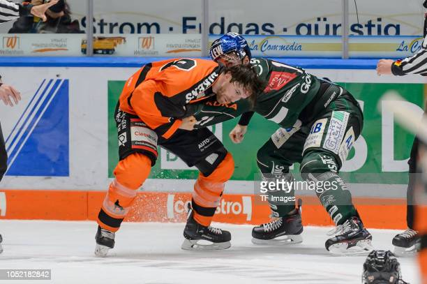 Jeffrey Likens of Grizzlys Wolfsburg and Adam Payerl of Augsburger Panther fight during the DEL match between Augsburger Panther and Grizzlys...