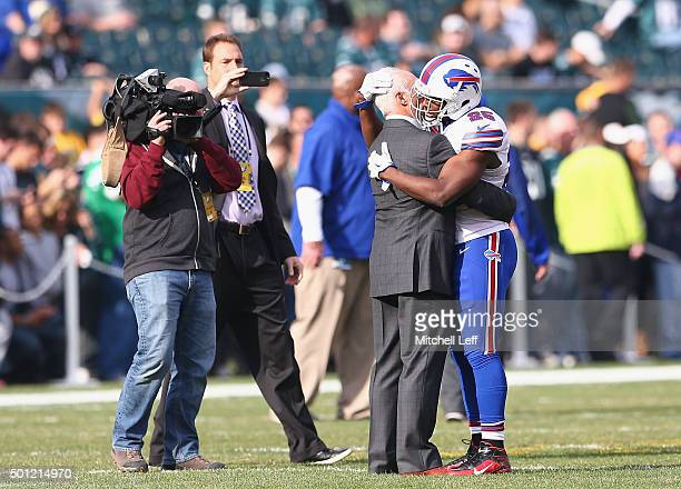 Jeffrey Lurie, Owner of the Philadelphia Eagles, embraces former Philadelphia Eagle LeSean McCoy of the Buffalo Bills before the start of the game at...