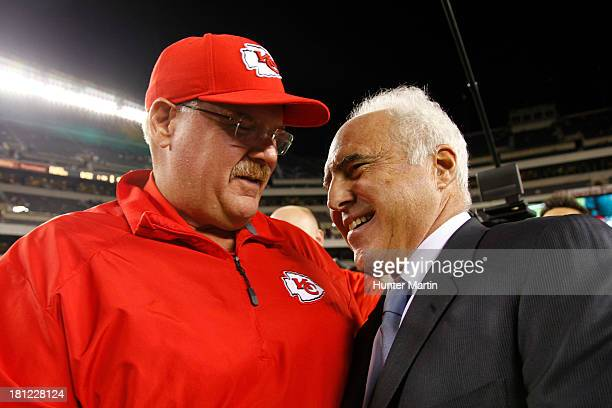 Jeffrey Lurie, owner of the Philadelphia Eagles, greets head coach Andy Reid of the Kansas City Chiefs before a game on September 19, 2013 at Lincoln...