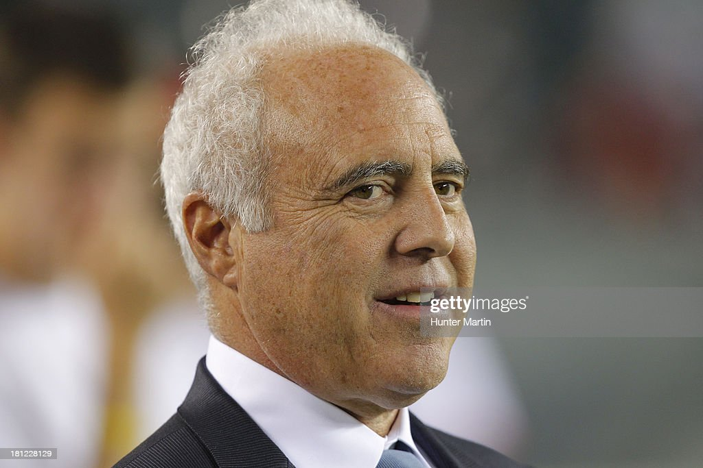 Jeffrey Lurie, owner of the Philadelphia Eagles, stands on the field before a game against the Kansas City Chiefs on September 19, 2013 at Lincoln Financial Field in Philadelphia, Pennsylvania. The Chiefs won 26-16.