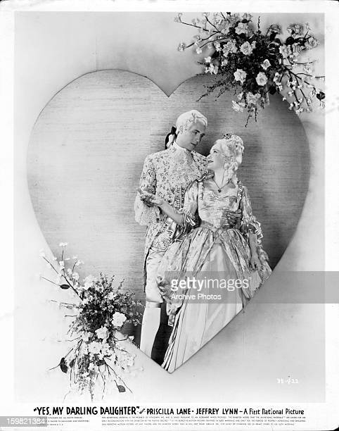 Jeffrey Lynn holding Priscilla Lane in movie art for the film 'Yes My Darling Daughter' 1939