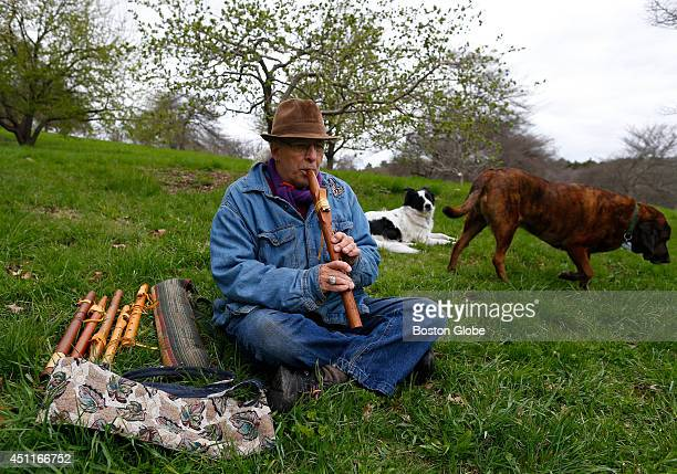 Jeffrey Marguiles plays at the Arnold Arboretum as his dogs Xena center and Randy right sit beside him in Boston Mass on April 28 2014
