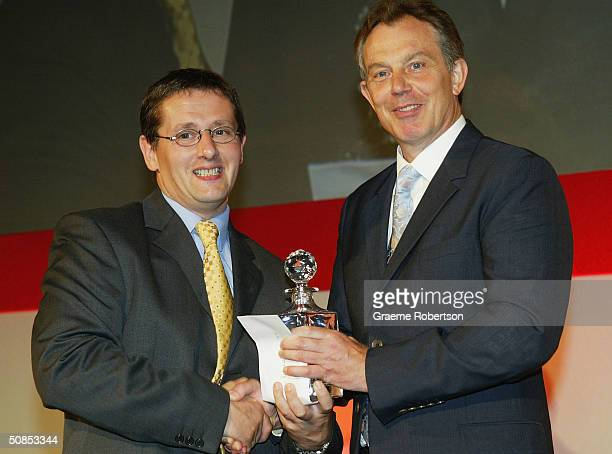 Jeffrey Mitchell of Reuters is presented with the award for the Nikon Sports Photographer of the Year Award by Prime Minister Tony Blair at the...