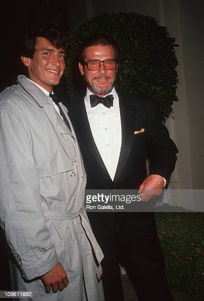 Jeffrey Moore and Roger Moore during Harry Winston Jewelers PreOscar Party at L'Orangerie Restaurant in West Hollywood California United States
