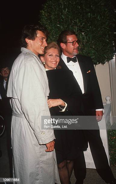 Jeffrey Moore Luisa Moore and Roger Moore during Harry Winston Jewelers PreOscar Party at L'Orangerie Restaurant in West Hollywood California United...