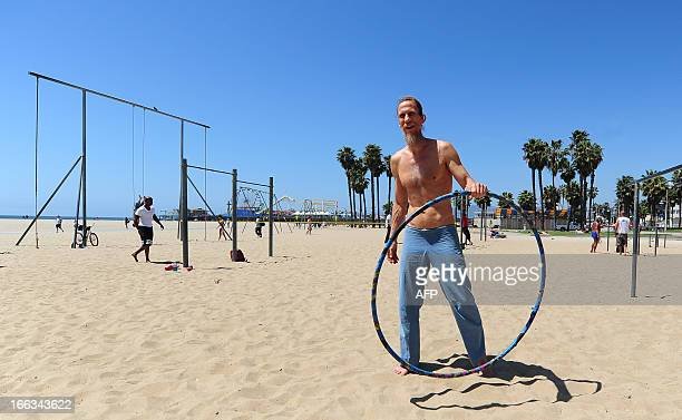 Jeffrey Nash holds his hula hoop before making his successful attempt at a Guiness World Record for hula hooping while on the rings at the beach in...