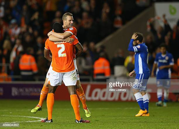 Jeffrey Rentmeister and Donervon Daniels of Blackpool celebrate after victory over Cardiff City in the Sky Bet Championship match between Blackpool...