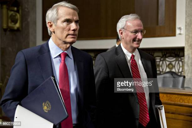 Jeffrey Rosen deputy transportation secretary nominee for US President Donald Trump right and Senator Rob Portman a Republican from Ohio arrive to a...