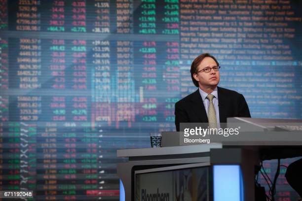 Jeffrey Rosenberg chief fixed income strategist at BlackRock Financial Management Inc listens during a Bloomberg Television interview in New York US...