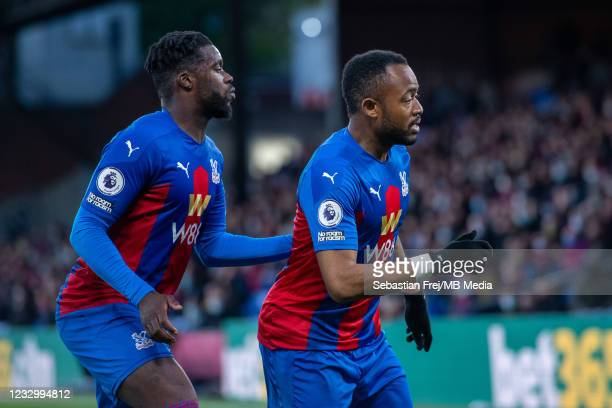 Jeffrey Schlupp and Jordan Ayew of Crystal Palace during the Premier League match between Crystal Palace and Arsenal at Selhurst Park on May 19, 2021...