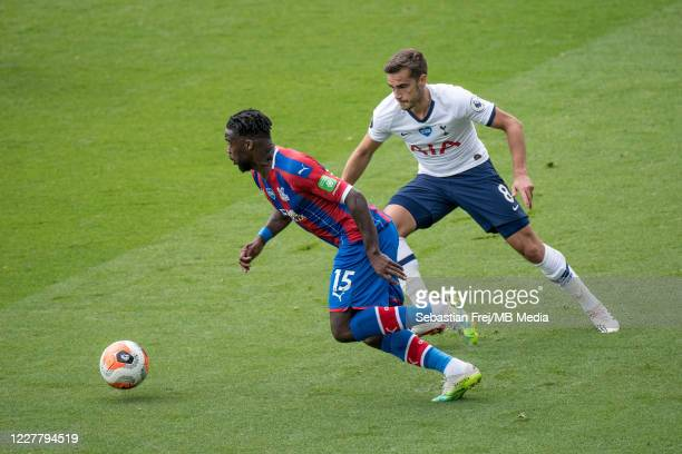 Jeffrey Schlupp of Crystal Palace and Harry Winks of Tottenham Hotspur in action during the Premier League match between Crystal Palace and Tottenham...