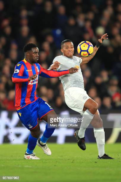 Jeffrey Schlupp of Crystal Palace and Luis Antonio Valencia of Man Utd battle for the ball during the Premier League match between Crystal Palace and...