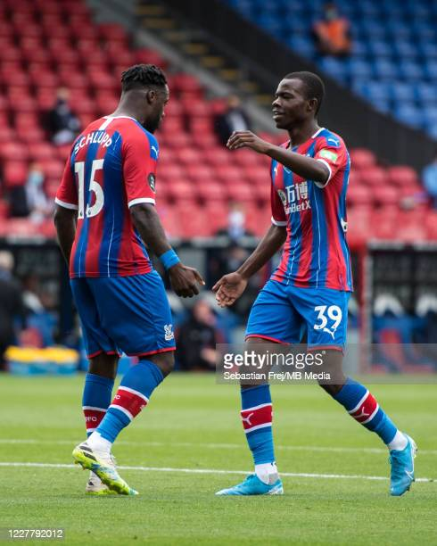 Jeffrey Schlupp of Crystal Palace celebrate with Tyrick Mitchell after scoring goal during the Premier League match between Crystal Palace and...