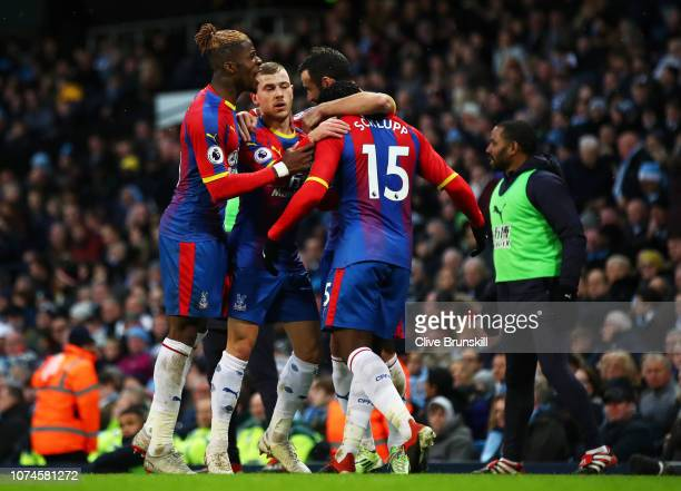 Jeffrey Schlupp of Crystal Palace celebrates after scoring his team's first goal with his team mates during the Premier League match between...