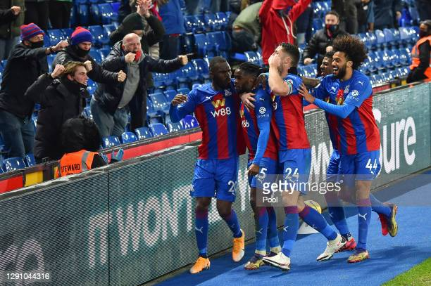 Jeffrey Schlupp of Crystal Palace celebrates to the fans with Gary Cahill and Christian Benteke after scoring their team's first goal during the...