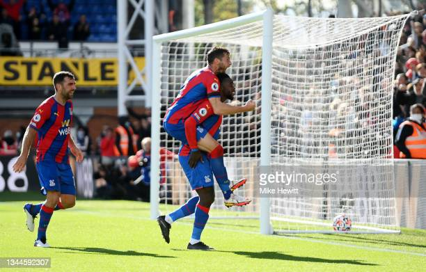 Jeffrey Schlupp of Crystal Palace celebrates with teammate Joel Ward after scoring their side's second goal during the Premier League match between...