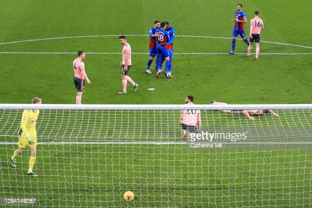 Jeffrey Schlupp of Crystal Palace celebrates with teammates after scoring their team's first goal during the Premier League match between Crystal...