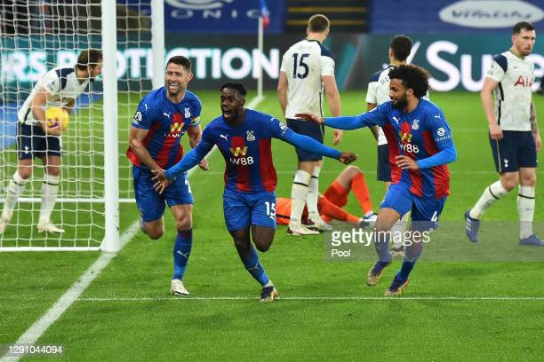 Jeffrey Schlupp of Crystal Palace celebrates with teammates Luka Milivojevic and Gary Cahill after scoring their team's first goal during the Premier...