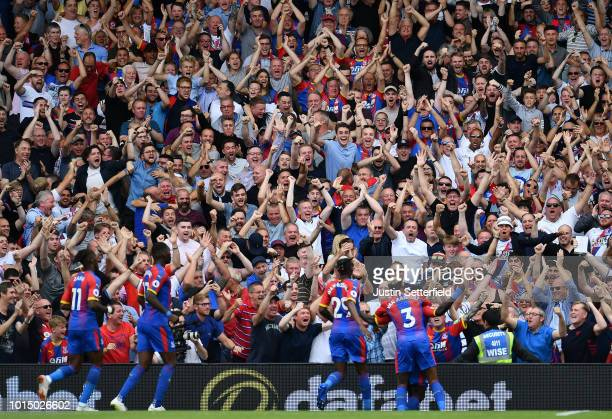Jeffrey Schlupp of Crystal Palace celebrates with the Crystal Palace fans after scoring his team's first goal during the Premier League match between...