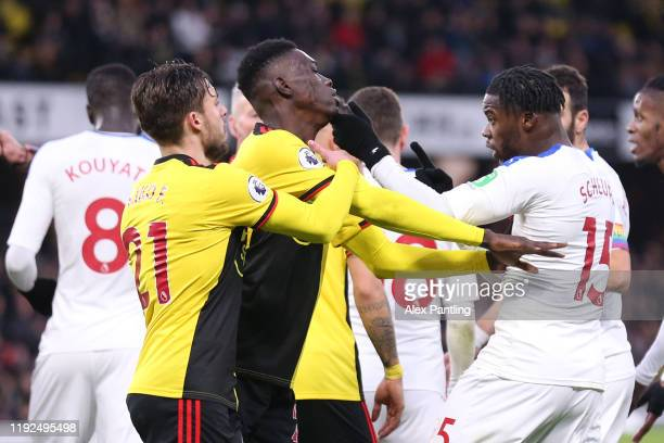 Jeffrey Schlupp of Crystal Palace clashes with Ismaila Sarr of Watford during the Premier League match between Watford FC and Crystal Palace at...