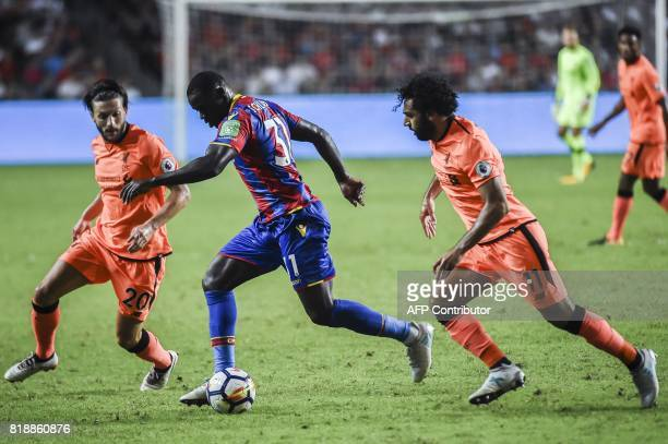 Jeffrey Schlupp of Crystal Palace controls the ball between Adam Lallana and Mohamed Salah of Liverpool FC during a 2017 Premier League Asia Trophy...