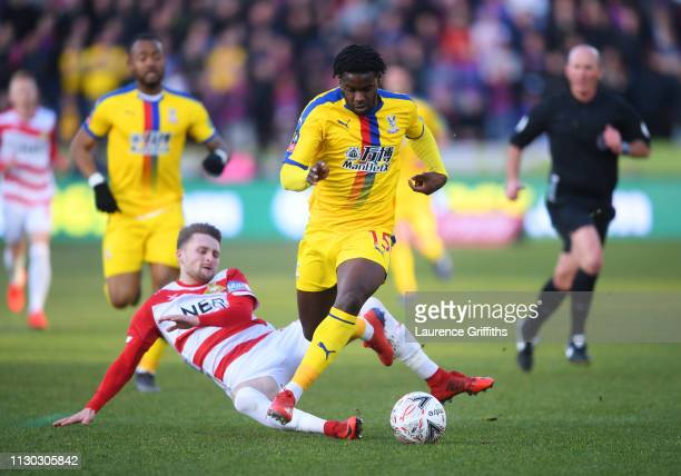 Jeffrey Schlupp of Crystal Palace evades Alfie May of Doncaster Rovers as breaks away to score his team's first goal during the FA Cup Fifth Round...