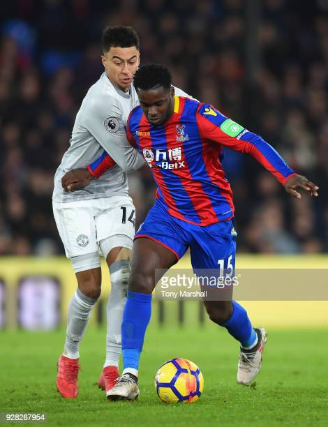 Jeffrey Schlupp of Crystal Palace holds off a challenge from Jesse Lingard of Manchester United during the Premier League match between Crystal...