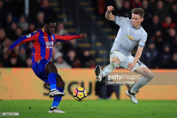 Jeffrey Schlupp of Crystal Palace in action with Scott McTominay of Manchester United during the Premier League match between Crystal Palace and...