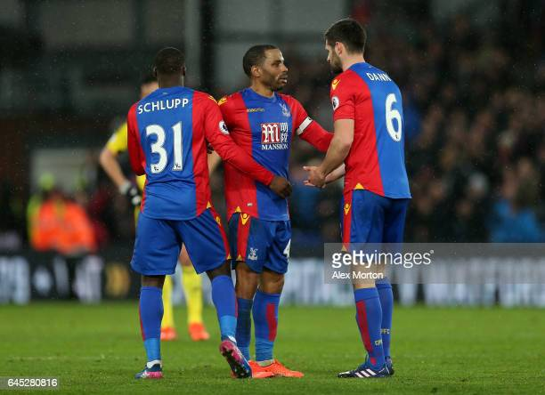 Jeffrey Schlupp of Crystal Palace Jason Puncheon of Crystal Palace and Scott Dann of Crystal Palace embrace after the Premier League match between...
