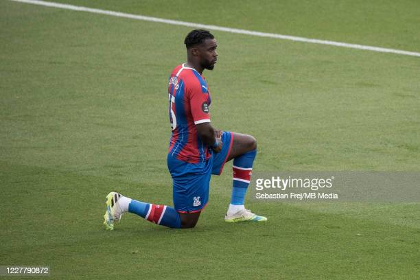 Jeffrey Schlupp of Crystal Palace take a knee during the Premier League match between Crystal Palace and Tottenham Hotspur at Selhurst Park on July...
