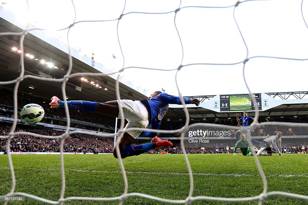 Jeffrey Schlupp of Leicester City fails in his attempt to clear the ball as he scores an own goal during the Barclays Premier League match between Tottenham Hotspur and Leicester City at White Hart Lane on March 21, 2015 in London, England.