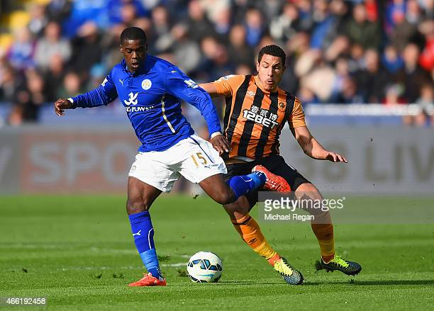 Jeffrey Schlupp of Leicester City is marshalled by Jake Livermore of Hull City during the Barclays Premier League match between Leicester City and...