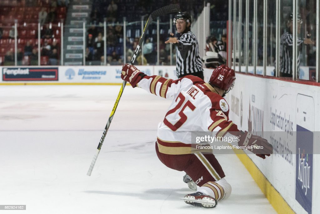 Jeffrey Truchon-Viel #25 of the Acadie-Bathurst Titan celebrates his game wining goal against the Gatineau Olympiques on October 18, 2017 at Robert Guertin Arena in Gatineau, Quebec, Canada.