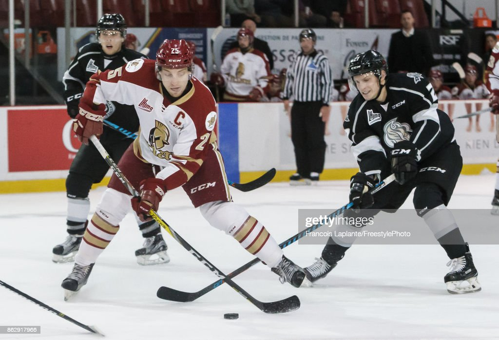 Jeffrey Truchon-Viel #25 of the Acadie-Bathurst Titan fires a shot as Anthony Gagnon #27 of the Gatineau Olympiques defends on October 18, 2017 at Robert Guertin Arena in Gatineau, Quebec, Canada.