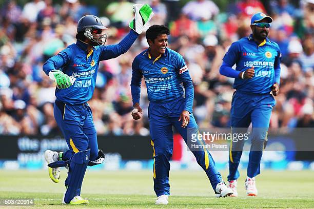 Jeffrey Vandersay of Sri Lanka celebrates with Dinesh Chandimal of Sri Lanka after dismissing Corey Anderson of the Black Caps during the Twenty20...