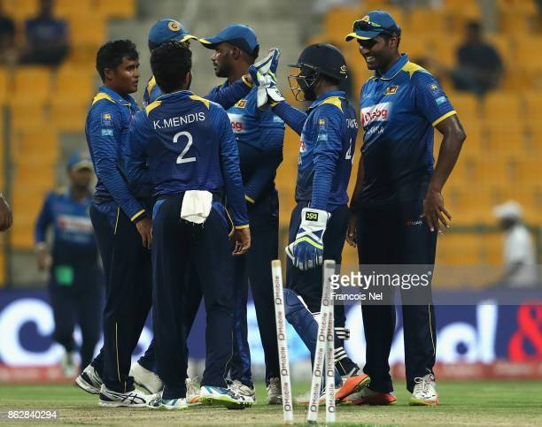 Jeffrey Vandersay of Sri Lanka celebrates with teammates after dismissing Fakhar Zaman of Pakistan during the third One Day International match...